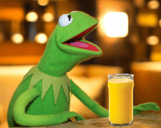 Kermit about to enjoy a refreshing glass of orange juice.png